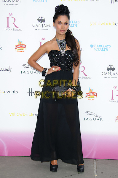 Preeya Kalidas.India Rocks Party at The Natural History Museum - Arrivals. London, England..June 27th, 2011.full length black maxi dress strapless clutch bag hand on hip necklace .CAP/CJ.©Chris Joseph/Capital Pictures.