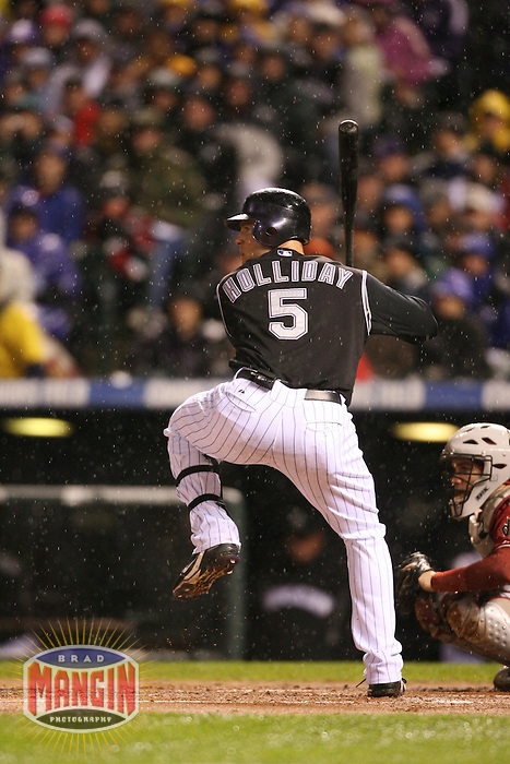 DENVER, CO - Matt Holliday of the Colorado Rockies bats in Game 3 of the National League Championship Series against the Arizona Diamondbacks at Coors Field in Denver, Colorado on October 14, 2007. Photo by Brad Mangin