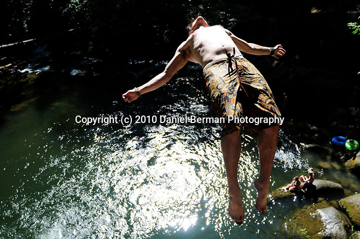 People enjoy the upper-80 degree weather with swimming, cliff diving and relaxing at Whatcom Falls Park in Bellingham Wednesday July 7, 2010. Photo by Daniel Berman/www.bermanphotos.com