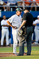 May 31, 2009:  NCAA Division 1 Gainesville Regional:    Miami head coach Jim Morris (3) argues with home plate umpire David Wiley after batter was not awarded first base after allegedly being hit by a pitch during regional action at Alfred A. McKethan Stadium on the campus of University of Florida in Gainesville.  Morris was later ejected from the game. The Florida Gators defeated the Miami Hurricanes 16-5 and will advance to the Super Regionals in Gainesville............