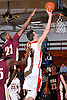 Donatas Kupsas #13 of Long Island Lutheran, right, drives past Josh Alexander #21 of Iona Prep during a varsity boys' basketball game at Long Island Lutheran High School on Tuesday, Jan. 26, 2016. Kupsas tallied 15 points and seven rebounds in Lutheran's 58-47 win.