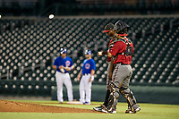 AZL Diamondbacks starting pitcher Wilfry Cruz (11) is visited by catcher Jose Herrera (23) during the game against the AZL Cubs on August 11, 2017 at Sloan Park in Mesa, Arizona. AZL Cubs defeated the AZL Diamondbacks 7-3. (Zachary Lucy/Four Seam Images)