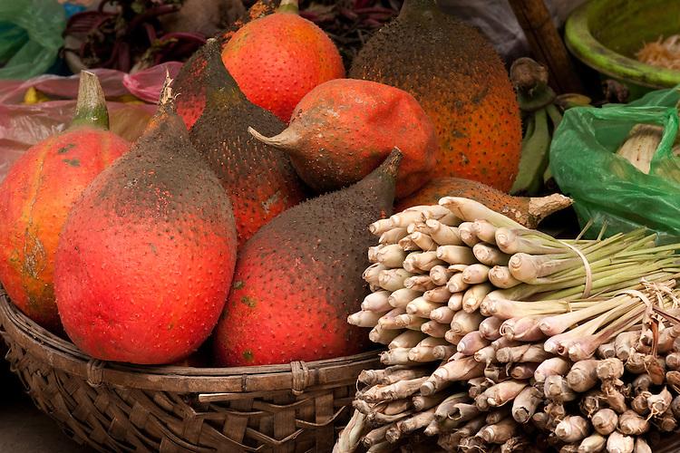 Basket of gac fruit and lemongrass, Nguyen Thien Thuat St, near Cho Dong Xuan market, Hanoi Old Quarter, Vietnam