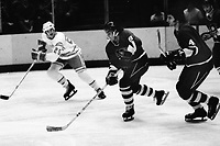 Seals vs. Pittsburg Penguins 1975. Rick Kehoe and Dave Burrows and Seals Al MacAdam. (photo/Ron Riesterer)