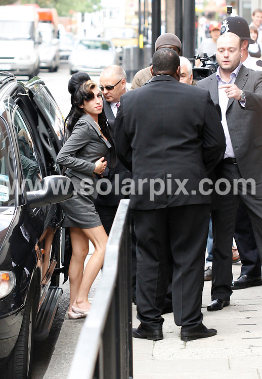 **ALL ROUND PICTURES FROM SOLARPIX.COM**.**NO UK NEWSPAPER PUBLICATION**.**UK MAGAZINE & SUPPLEMENT PUBLICATION ONLY** AND NO PUBLICATION IN AUSTRALIA, FRANCE, GERMANY, ITALY AND SCANDINAVIA** .Amy Winehouse is pictured arriving at the City Of Westminster magistrates court in London this morning. The 25 year old singer is on trial for an assault charge after she is said to have punched a fan in the eye for asking to be photographed with the fan's friend. London, UK. 23 July 2009..This pic: Amy Winehouse..JOB REF: 9588 SFE       DATE: 23_07_2009.**MUST CREDIT SOLARPIX.COM OR DOUBLE FEE WILL BE CHARGED**.**MUST NOTIFY SOLARPIX OF ONLINE USAGE**.**CALL US ON: +34 952 811 768 or LOW RATE FROM UK 0844 617 7637**