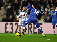 Pictured L-R: Leon Britton of Swansea against Romelu Lukaku of Chelsea. Tuesday, 31 January 2012<br />