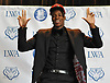 Lawrence Woodmere Academy's Aidan Igiehon, a 6'10 basketball standout from Ireland, poses for pictures after selecting the University of Louisville as his college choice at a news conference at Lawrence Woodmere Academy on Friday, Oct. 19, 2018.