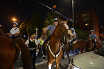 Police end the sit in by charging at demonstrators with horses at the intersection of Roosevelt and State Street in the South Loop in Chicago, Illinois on July 9, 2016.  Protests erupted nationwide following the police shootings of Alton Sterling who was selling bootleg DVDs outside a convenience store in Baton Rouge, Louisiana and Philando Castile during a routine traffic stop for a broken tail light in the St. Paul, Minneapolis suburb of Falcon Heights; on Thursday night, a lone gunman Micah Johnson fired and killed five police officers and injured several others during a Black Lives Matter protest in Dallas.