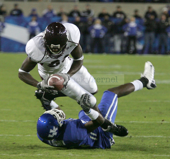 Mississippi State wide receiver O'Neal Wilder is taken down by Kentucky cornerback Randall Burden in the first half of the game at Commonwealth Stadium Saturday night..Photo by Zach Brake | Staff.