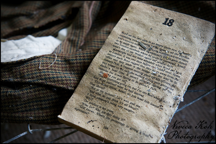 Part of a paperback novel and a tweed jacket