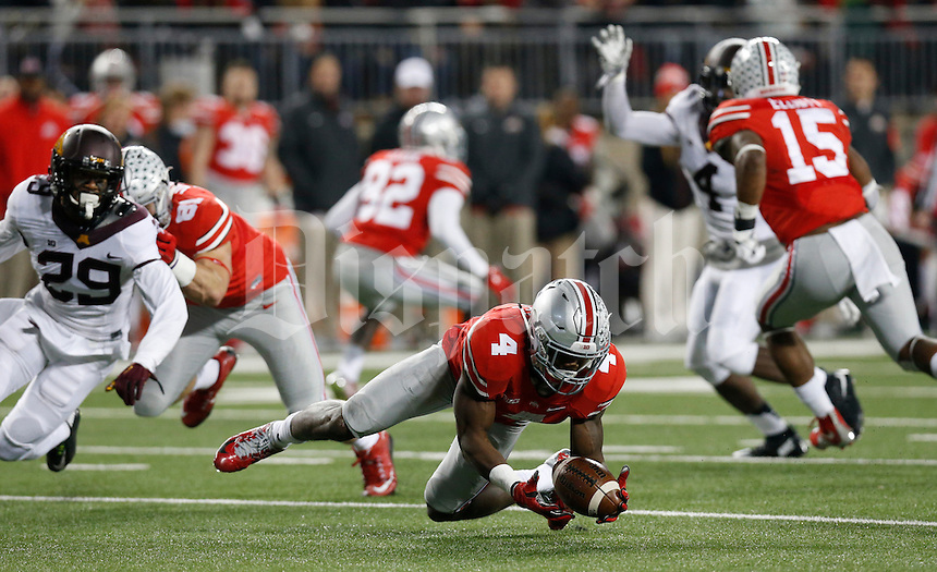 Ohio State Buckeyes running back Curtis Samuel (4) scoops up a fumble by Ohio State Buckeyes quarterback Cardale Jones (12) during Saturday's NCAA Division I football game against the Minnesota Golden Gophers at Ohio Stadium in Columbus on November 7, 2015. (Dispatch Photo by Barbara J. Perenic)