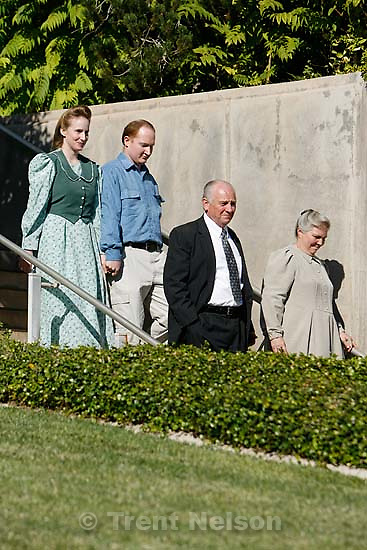 The Warren Jeffs' trial in St. George, Utah. Jeffs, head of the Fundamentalist Church of Jesus Christ of Latter Day Saints, is charged with two counts of rape as an accomplice for allegedly coercing the marriage and rape of a 14-year-old follower to her 19-year-old cousin in 2001.. apparent followers of warren jeffs' flds church, younger couple at left is Joanna Keate and John Keate.
