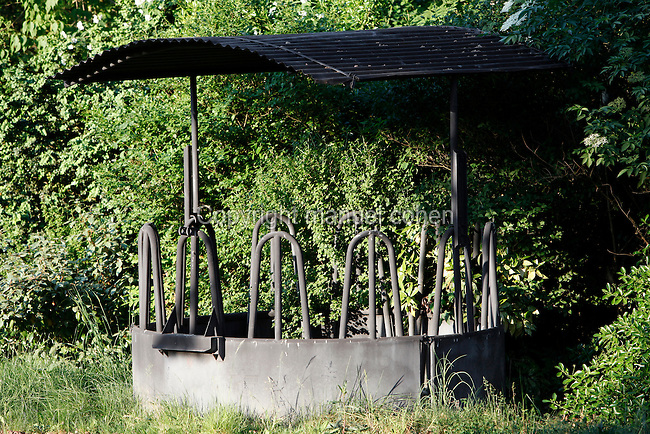 Detail of eating trough surrounded by vegetation, Parc Zoologique de Paris, or Zoo de Vincennes, (Zoological Gardens of Paris, also known as Vincennes Zoo), 1934, by Charles Letrosne, 12th arrondissement, Paris, France, pictured on May 3, 2011 in the evening. In November 2008 the 15 hectare Zoo, part of the Museum National d'Histoire Naturelle (National Museum of Natural History) closed its doors to the public and renovation works will start in September 2011. The Zoo is scheduled to re-open in April 2014. Picture by Manuel Cohen.