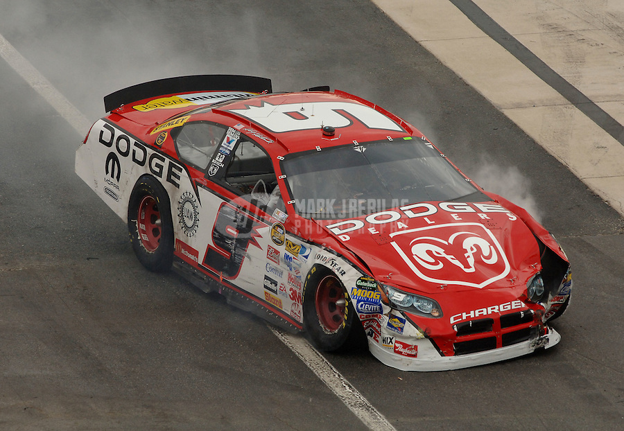 Sept. 24, 2006; Dover, DE, USA; Nascar Nextel Cup driver Kasey Kahne (9) heads to the garage after crashing with Tony Stewart (20) during the Dover 400 at Dover International Speedway. Mandatory Credit: Mark J. Rebilas