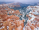 Bryce Canyon National Park, UT: Snow storm clearing over hoodos and forest of Bryce Canyon