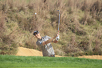 Nicolas Colsaerts (BEL) chips from a bunker at the 8th green during Sunday's Final Round of the 2014 BMW Masters held at Lake Malaren, Shanghai, China. 2nd November 2014.<br /> Picture: Eoin Clarke www.golffile.ie