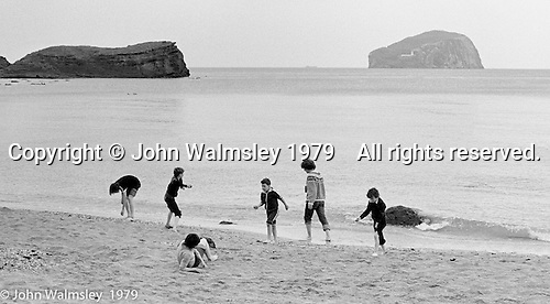 Kids from Wester Hailes taken by Youth Workers on a visit to the beach near Dunbar, East Lothian, Scotland, 1979.  John Walmsley was Photographer in Residence at the Education Centre for three weeks in 1979.  The Education Centre was, at the time, Scotland's largest purpose built community High School open all day every day for all ages from primary to adults.  The town of Wester Hailes, a few miles to the south west of Edinburgh, was built in the early 1970s mostly of blocks of flats and high rises.