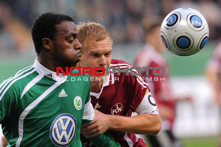FBL 09/10  13. Spieltag Hinrunde / Stadion: Volkswagen Arena<br /> VfL Wolfsburg vs 1.FC Nuernberg<br /> Grafite (Wolfsburg #23) versucht sich gegen Andreas Wolf (Nuernberg #05) durchzusetzen.<br /> Foto &copy; nph ( nordphoto ) *** Local Caption *** *** Local Caption *** <br /> Fotos sind ohne vorherigen schriftliche Zustimmung ausschliesslich fŁr redaktionelle Publikationszwecke zu verwenden.<br /> <br /> Auf Anfrage in hoeherer Qualitaet/Aufloesung