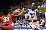 17 November 2013: Duke's Chelsea Gray (12) moves past Alabama's Sharin Rivers (33) with a fake pass. The Duke University Blue Devils played the University of Alabama Crimson Tide at Cameron Indoor Stadium in Durham, North Carolina in a 2013-14 NCAA Division I Women's Basketball game. Duke won the game 92-57.