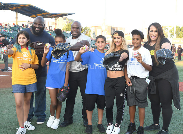 Brooklyn, NY - AUGUST 17: WWE Superstars  Mark Henry. Apollo Crews,Carmella and Nia Jax visits MCU Park in Brooklyn, New York on August 17, 2017 during Summer Slam Week. Photo Credit: George Napolitano/MediaPunch