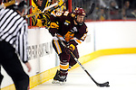 09 APR 2011: Wade Bergman (28) of University of Minnesota, Duluth moves the puck down the ice during the Division I Men's Ice Hockey Championship held at the Xcel Energy Center in St. Paul, MN.  Minnesota-Duluth beat Michigan in overtime, 3-2 to claim the national title. Vince Muzik/NCAA Photos