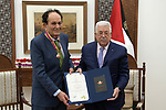 """Palestinian President Mahmoud Abbas, honors and brands novelist and media journalist Ziad Abdel Fattah, Medal of Culture, Science and Arts, """"the level of radiance in the West Bank city of Ramallah, on February 25, 2020. Photo by Thaer Ganaim"""