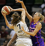 Phoenix player Kelly Mazzante (33) blocks San Antonio's Erin Buescher (7) during the WNBA game between the San Antonio Silver Stars and the Phoenix Mercury, May 20, 2008, at the AT&T Center, San Antonio, Texas. San Antonio won 81 - 76. (Darren Abate/PressPhotoIntl.com)