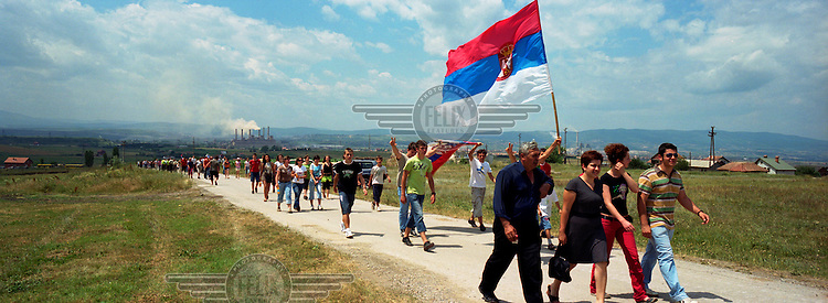 Serbs walk to the Gazemestan monument for a religious service in commemoration of the Battle of Kosovo Field in 1389. Every year Serbs visit the site to hold a religious ceremony commemorating the battle, which they lost, and which they see as the moment when they lost control of their country and the Balkans to the Muslim Ottoman Empire which was in control for the next 500 years.