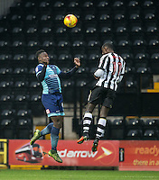 Aaron Pierre of Wycombe Wanderers beats Jonathan Forte of Notts Co to the ball during the Sky Bet League 2 match between Notts County and Wycombe Wanderers at Meadow Lane, Nottingham, England on 10 December 2016. Photo by Andy Rowland.
