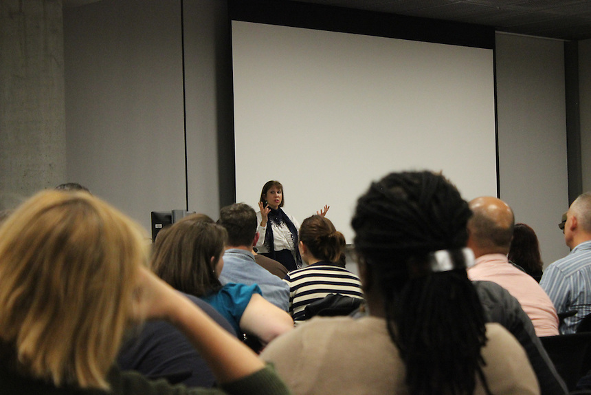 Audience members listen to Associate Professor Martie Cook discuss how to create a TV pilot during a lecture at Emerson Los Angeles on Wednesday, December 3, 2014.