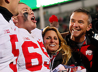 Urban and Shelley Meyer celebrate Ohio State's 49-37 win over Michigan State in the NCAA football game at Spartan Stadium in East Lansing, Michigan on Nov. 8, 2014. (Adam Cairns / The Columbus Dispatch)