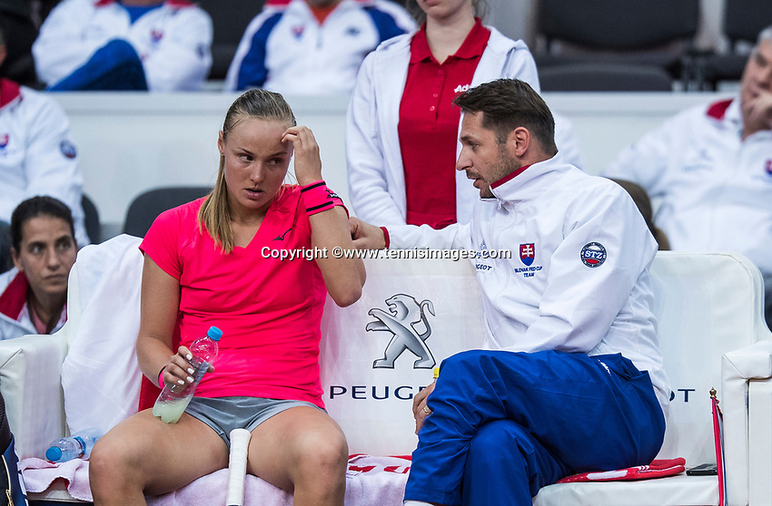Bratislava, Slovenia, April 22, 2017,  FedCup: Slovakia-Netherlands, seccond rubber : Rebecca Sramkova (SVK) on the bench with captain Matej Liptak<br /> Photo: Tennisimages/Henk Koster