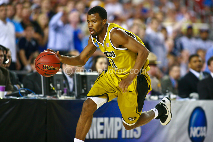 Mar 26, 2009; Tucson, AZ, USA; Missouri Tigers guard Zaire Taylor (11) dibbles the ball near the sidelines in the second half of a game against the Memphis Tigers in the semifinals of the west region of the 2009 NCAA basketball tournament at University of Phoenix Stadium.    Missouri defeated Memphis 102-91.