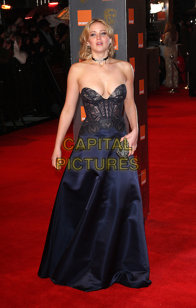 JENNIFER LAWRENCE.2011 Orange British Academy Film Awards (Baftas) at The Royal Opera House, London, England, UK,.February 13th, 2011..arrivals BAFTA full length navy blue dress cleavage strapless clutch bag black bodice bustier .CAP/ROS.©Steve Ross/Capital Pictures