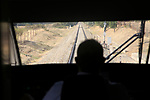 Rear view of male train driver driving a RENFE train, Spain
