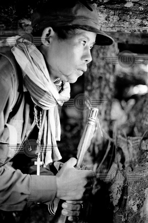 A Karenni guerrilla staring out from a bunker, anticipating the Burma Army's impending ground offensive during the second battle for Ember Hill.
