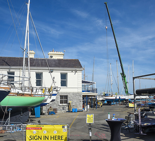 Sign-In to lift-in: The National Yacht Club cruisers were lifted in for the summer season at the weekend