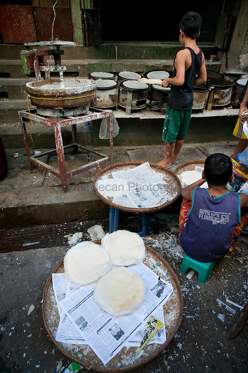 Making rice pancake in Yangon, Myanmar
