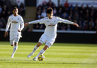 SWANSEA, WALES - FEBRUARY 21: Ki Sung Yueng of Swansea during the Barclays Premier League match between Swansea City and Manchester United at Liberty Stadium on February 21, 2015 in Swansea, Wales.