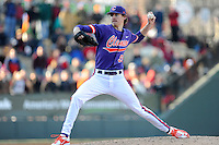 Starting pitcher Zack Erwin (33) of the Clemson Tigers delivers a pitch in the Reedy River Rivalry game against the South Carolina Gamecocks on Saturday, February 28, 2015, at Fluor Field at the West End in Greenville, South Carolina. South Carolina won, 4-1. (Tom Priddy/Four Seam Images)