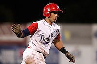 Auburn Doubledays catcher Wilfri Pena #16 celebrates after hitting a home run during game two of the semi-final round of the NY-Penn League Playoff series against the Vermont Lake Monstes at Falcon Park on September 8, 2011 in Auburn, New York.  Auburn defeated Vermont 3-2.  (Mike Janes/Four Seam Images)