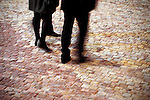 Close up of a couple walking on cobble stones
