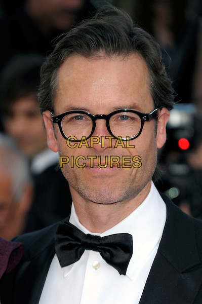 Guy Pierce.'Lawless' screening at the 65th  Cannes Film Festival, France 19th May 2012.portrait headshot glasses black bow tie  frames retro .CAP/PL.©Phil Loftus/Capital Pictures.