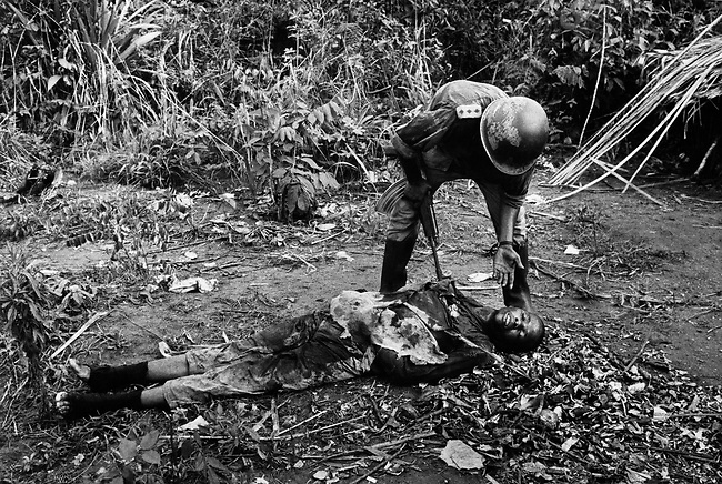 Ibo officer addressing one of his dead soldiers, civil war, Biafra, Nigeria April, 1968