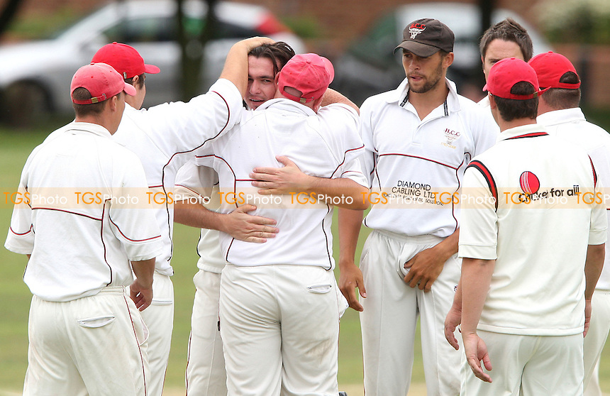 Hornchurch bowler Jamie Went celebrates after getting a wicket - Hornchurch Cricket Club vs Hutton Cricket Club at Harrow Lodge Park, Hornchurch - 04/07/09 - MANDATORY CREDIT: Rob Newell/TGSPHOTO - Self billing applies where appropriate - 0845 094 6026 - contact@tgsphoto.co.uk - NO UNPAID USE.