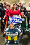 Albertson, New York, U.S. 26th October 2013. GIOVANNI GERRATO, 8 months, of Franklin Square, and his uncle ROBERT GERRATO, 6 years old, attended announcement that Cuomo endorsed Suozzi for Nassau County Executive, at the Albertson Veterans of Foreign Wars VFW Post. Democrat Suozzi, the former Nassau County Executive, and Republican incumbent Mangano face each other in a rematch in the upcoming November 5th election.