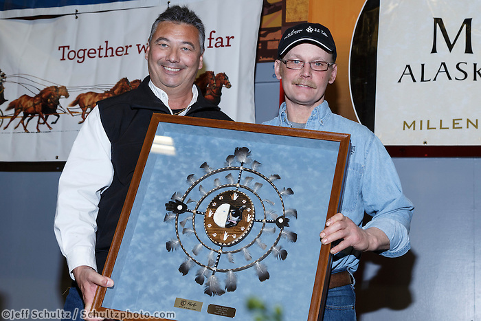 Mitch Seavey (L) recieves the PenAir Spirit of Alaska award from Danny Seybert of PenAir at the finishers banquet in Nome on Sunday  March 22, 2015 during Iditarod 2015.  <br /> <br /> (C) Jeff Schultz/SchultzPhoto.com - ALL RIGHTS RESERVED<br />  DUPLICATION  PROHIBITED  WITHOUT  PERMISSION