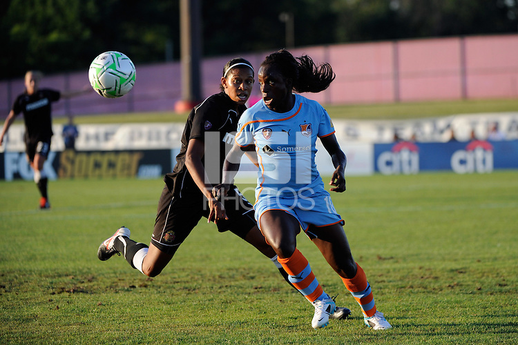 Eniola Aluko (18) of Sky Blue FC and Candace Chapman (5) of the Western New York Flash. The Western New York Flash defeated Sky Blue FC 4-1 during a Women's Professional Soccer (WPS) match at Yurcak Field in Piscataway, NJ, on July 30, 2011.