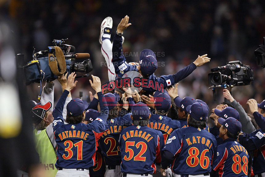 Japan Manager Sadaharu Oh is thrown in the air by his players after Japan wins the World Baseball Championship at Petco Park in San Diego,California on March 20, 2006. Photo by Larry Goren/Four Seam Images