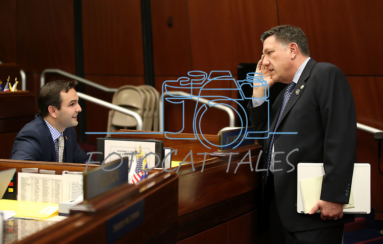 Nevada Assembly Republicans Derek Armstrong, left, and PK O'Neill talk on the Assembly floor at the Legislative Building in Carson City, Nev., on Monday, April 27, 2015. <br /> Photo by Cathleen Allison